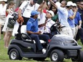 storm steals tiger's thunder as injury-hit woods walks off under a cloud again
